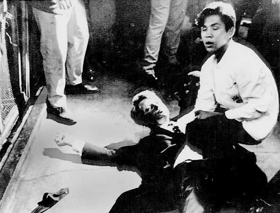 Robert Kennedy held by Juan Romero